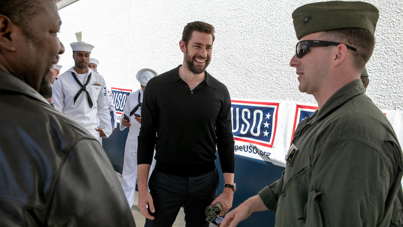 """Actors Wendell Pierce, left, and John Krasinski, co-stars of the new Amazon Prime series, """"Tom Clancy's Jack Ryan,"""" connect with service members during a USO tour during Los Angeles Fleet Week on August 31."""