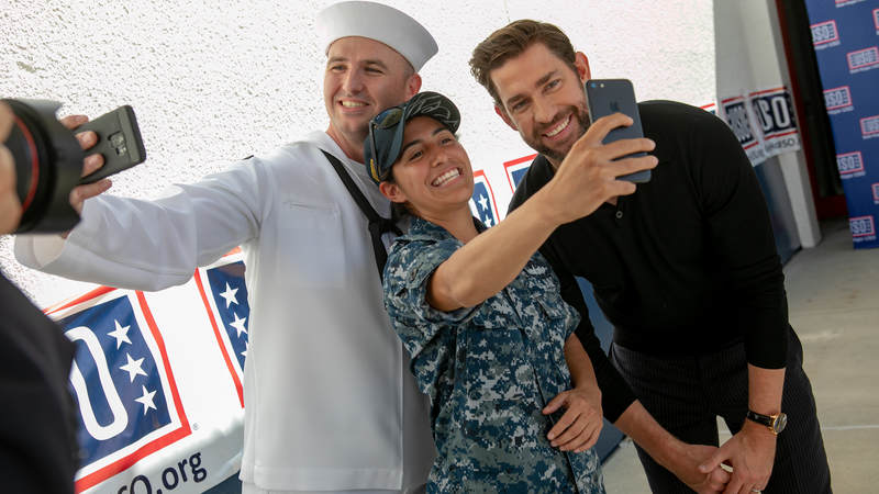 """Actor John Krasinski, who stars in the new Amazon Prime series, """"Tom Clancy's Jack Ryan,"""" poses with sailors during a USO tour during Los Angeles Fleet Week on August 31."""