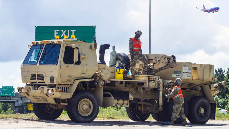 South Carolina Army National Guard soldiers stage recovery equipment to provide support for disabled vehicles during the lane reversal of I-26 in North Charleston, South Carolina during evacuations for Hurricane Florence.