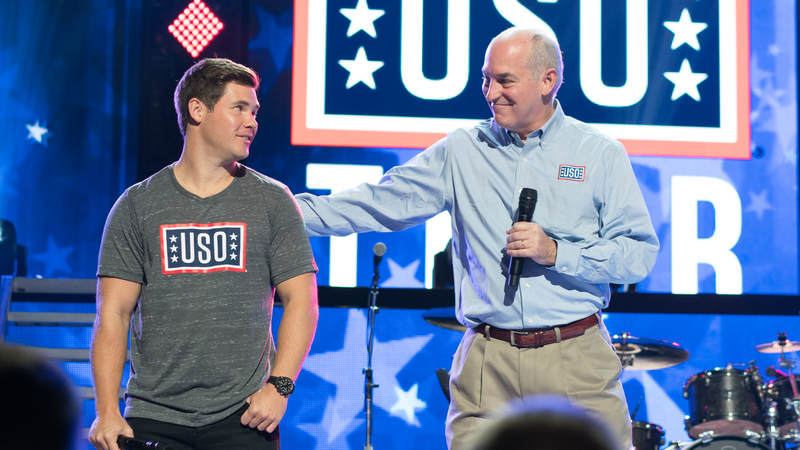 J.D. Crouch, CEO and President of the USO, shares the stage with comedian and USO tour veteran Adam Devine at the start of the World's Biggest USO Tour, a live entertainment experience at The Anthem in Washington, D.C., Sept. 12, 2018, bringing the USO mission to life and paying tribute to service members around the world.