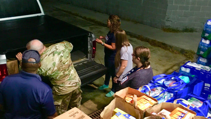 USO South Carolina staff and volunteers package and load care packages for service members providing hurricane relief along the east coast.
