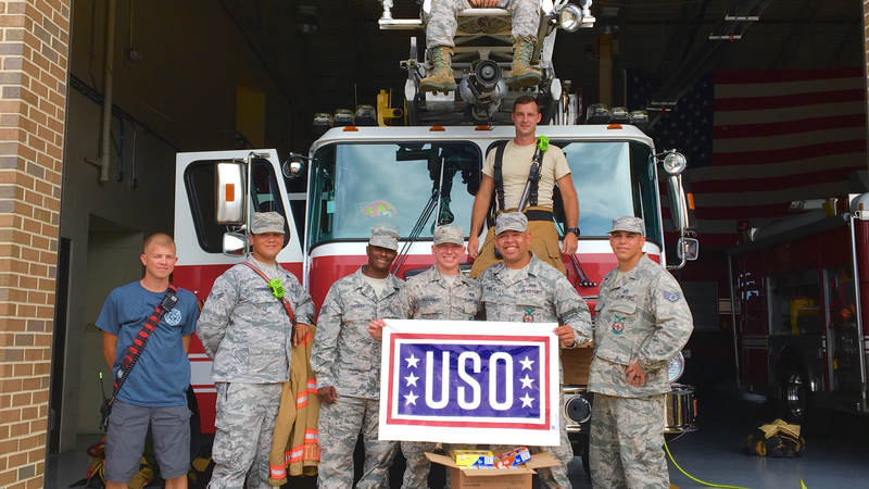 Members of the South Carolina National Guard volunteer with the USO to help prepare care packages for service members supporting hurricane relief efforts.