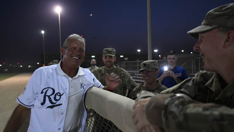 Former Kansas City Royals third baseman and designated hitter George Brett, who played for the Royals for 21 years, spends time with service members at a pickup softball game. USO Photo by Neal Preston
