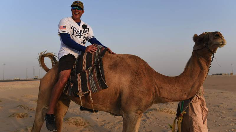 Former Kansas City Royals designated hitter and first baseman Mike Sweeney, who played for the Royals for 13 seasons, gets a taste of life in Kuwait while on tour with the USO. USO Photo by Neal Preston.