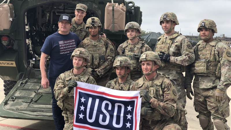 Jerrod Niemann poses with service members while on a tour of Fort Hood.