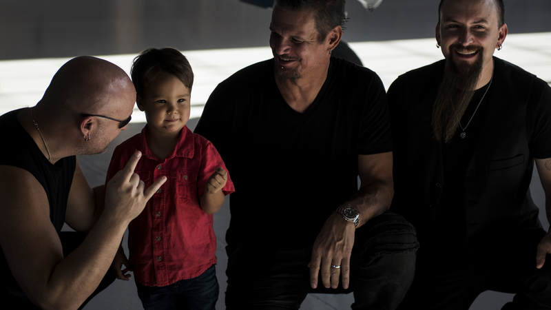 Members of the band Disturbed meet Air Force families during a tour of Nellis Air Force Base, Nevada, October 24.