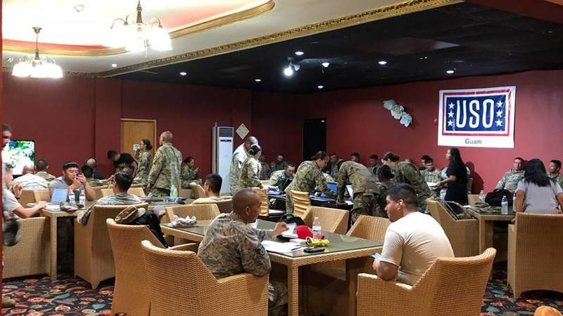 Service members enjoy a moment of relaxation in the temporary USO center built on the island of Saipan.