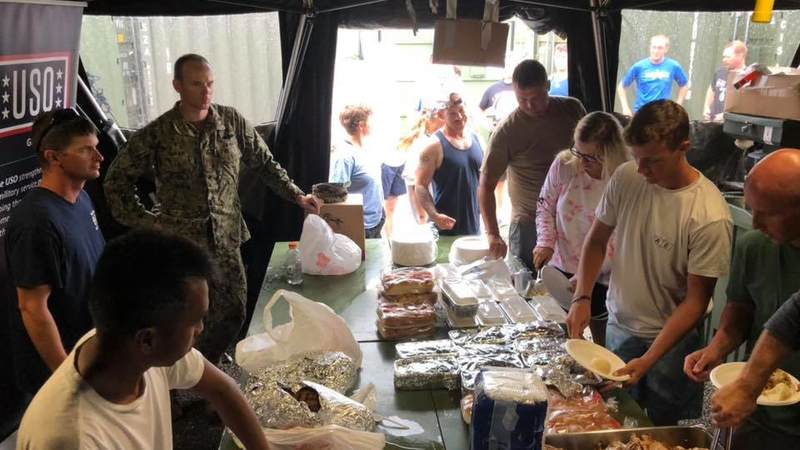 Service members deployed to Tinian for Typhoon Yutu enjoy a Thanksgiving meal, courtesy of the USO.