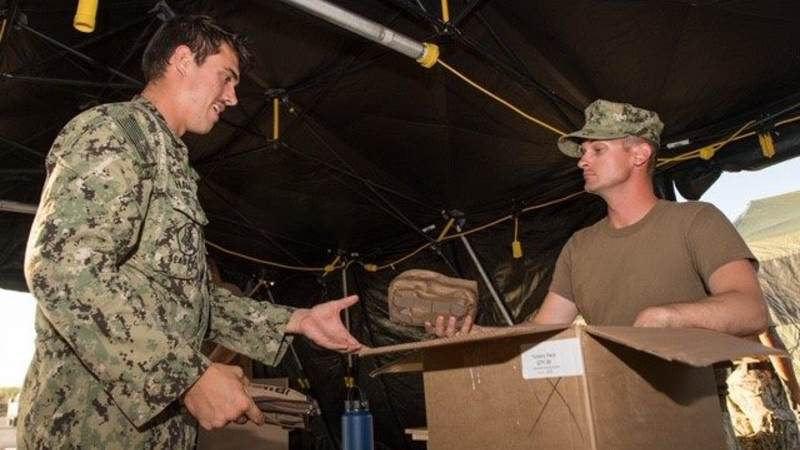 Service members receive USO Care Packages while deployed to Saipan and Tinian for Typhoon Yutu relief efforts.