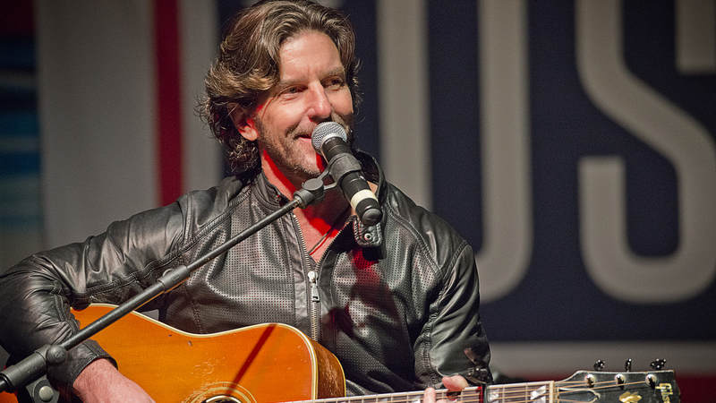 Singer-songwriter and record producer Brett James performs one of his hits for service members and their families.