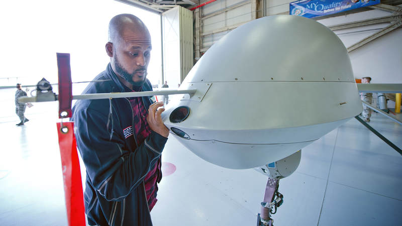 "Sydney Castillo checks out a MQ-1 ""Predator,"" a remotely piloted aircraft."