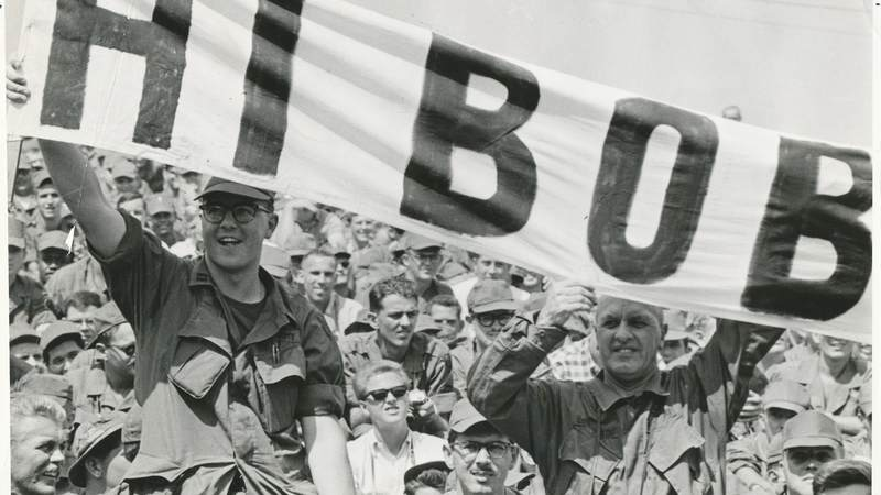 "Troops hold up a ""Hi Bob"" banner during one of Bob Hope's USO shows. USO photo"