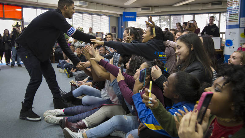 Jussie Smollett greets students at Yokota High School during a USO tour to Japan.