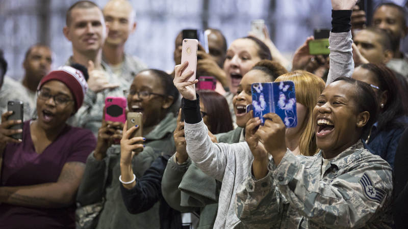 "Service members cheer and take photos as cast members from ""Empire"" visit Misawa Air Base in Japan during a USO tour."