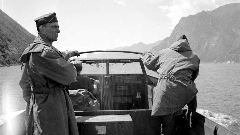 10th Mountain Division commander Army General George P. Hays, left, leads an American amphibious vehicle as it crosses an Italian lake during World War II.