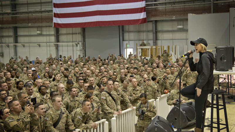 Country music star Kellie Pickler performs a USO concert for troops stationed at Bagram Air Base in Afghanistan as part of a six-day, five-country USO holiday tour led by Army General Martin Dempsey in 2014.