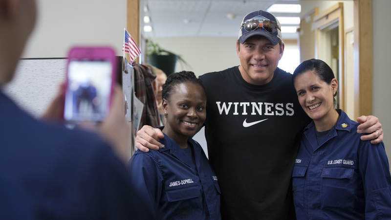 Country musician Rodney Atkins poses for a photo with service members at Coast Guard Air Station Kodiak, Alaska, on September 17.