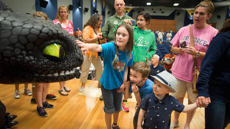 "Military personnel and their families get to meet with ""Toothless"" the dragon following a special advance USO screening of the movie ""How to Train Your Dragon 2,"" at Joint Base McGuire-Dix-Lakehurst, New Jersey, in 2014."