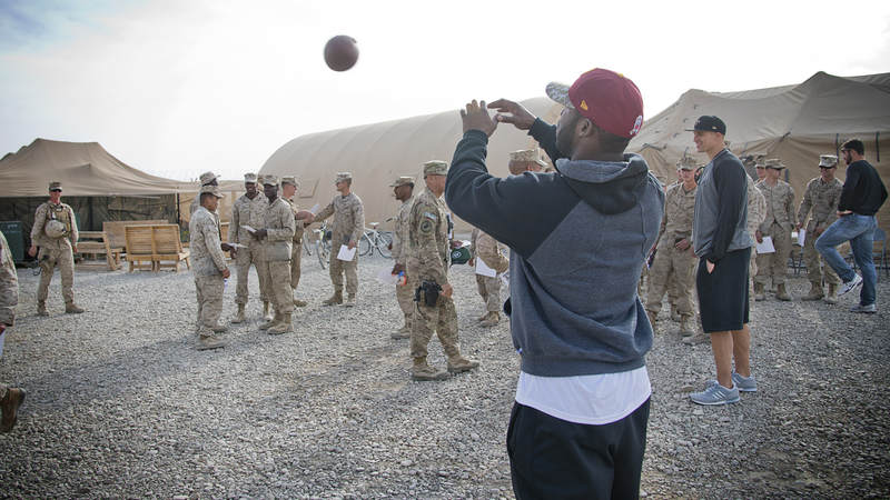 Pierre Garcon, of the Washington Redskins, plays catch with service members stationed in the Middle East in 2014.