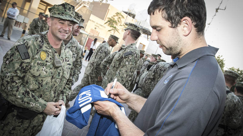Andrew Luck signs a shirt for a sailor at Naval Support Activities Bahrain during a 2015 tour.