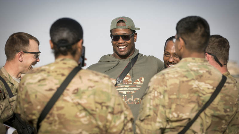 Denver Broncos linebacker Von Miller visits with troops stationed in the Middle East during a stop on his weeklong USO/NFL tour in 2013.