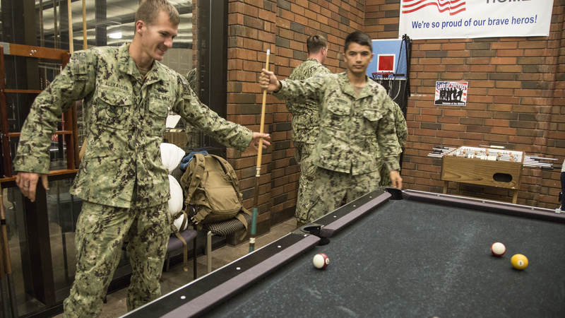 Navy Seabees play a game of pool Feb. 8 during a short layover at USO Ontario.