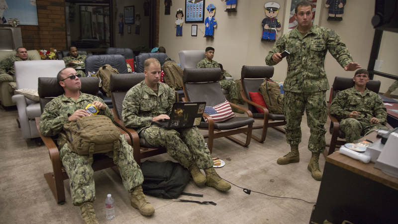 Navy Seabees relax in the entertainment room of USO Ontario on Feb. 8 during a short, late-night layover.