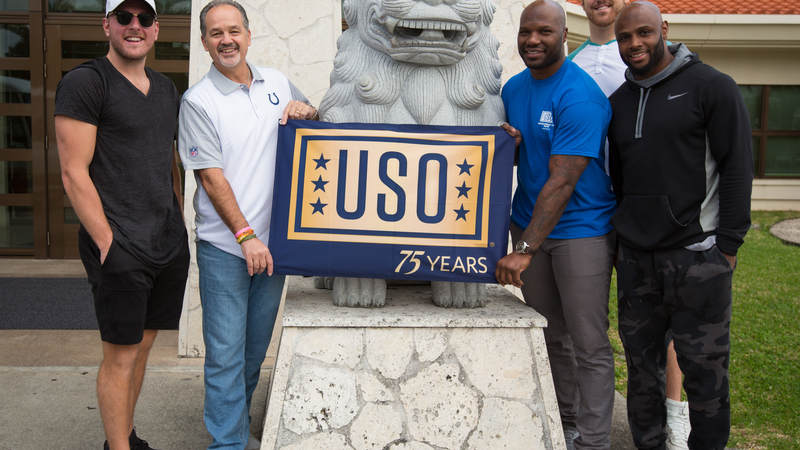Coach Pagano (second left), McAfee (left), Jackson (third right), Anthony Castonzo (second right) and Adams (right) pose for a photo with a Shisa during a USO tour stop at Camp Foster in Okinawa, Japan, on Feb. 19.