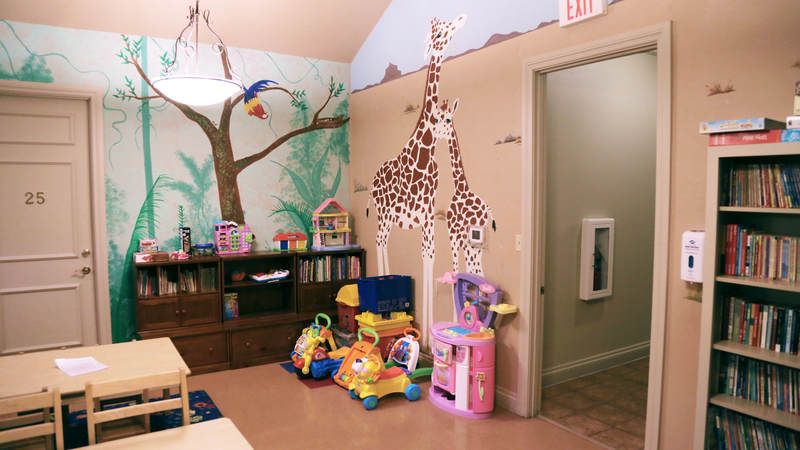 "At Fisher House at Lackland, murals of animals decorate the walls of a  ""war room"" designed for children's activities."