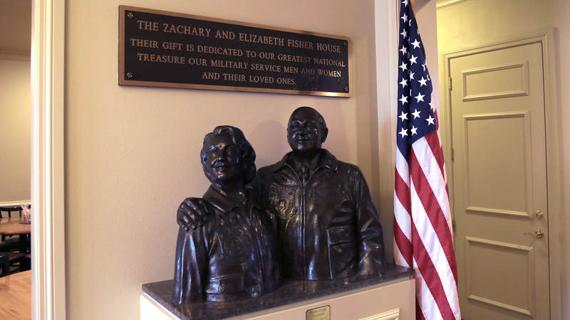 A bust of Zachary and Elizabeth Fisher, the organization's co-founders, sits near the front door.